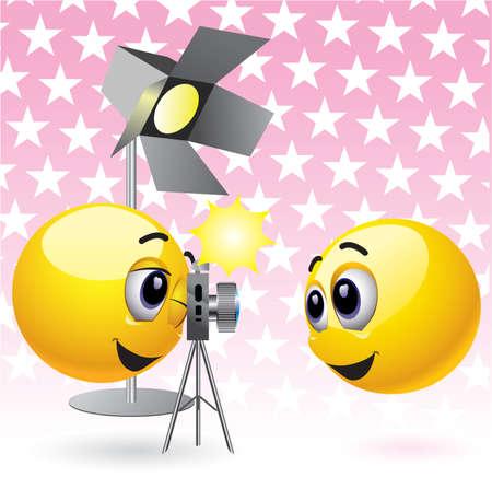 Smiling balls taking photographs in studio