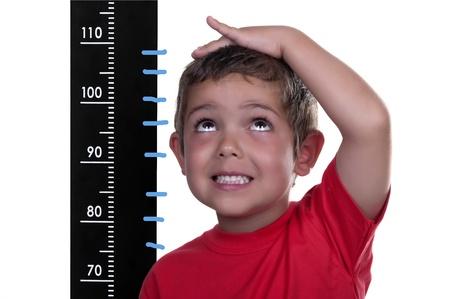 Photo pour measured child on white background - image libre de droit