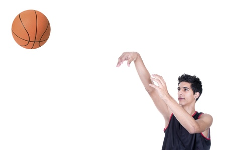 basketball player throwing the ball on white background