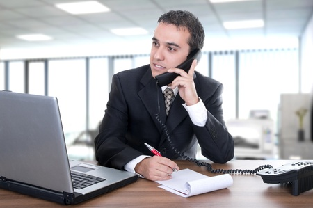 young businessman latino in office