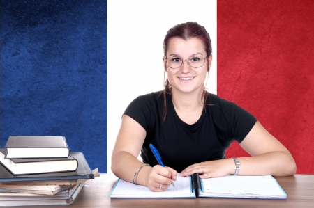 young girl student pc on the background with french national flag. french language learning concept