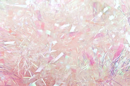 Pastel pink tinsel background, suitable for Christmas.