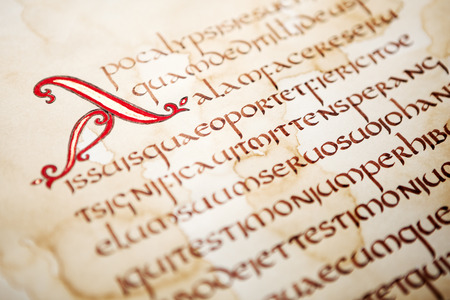 Calligraphic handwritten excerpt from Bible on a grunge paper, shallow dof.