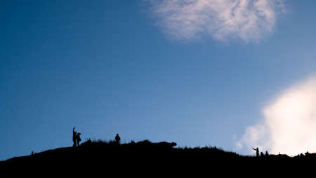 Silhouette shot, Group of tourist on high mountain, Phu chi fa, Chaingrai, Thailand