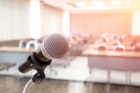 Photo pour Microphone on abstract blurred of speech in seminar room - image libre de droit