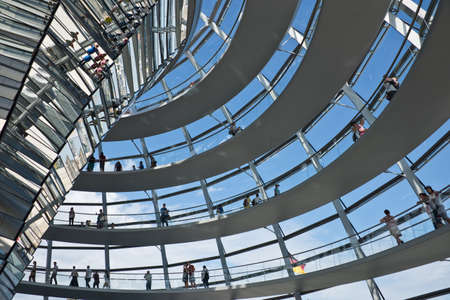 Tourists visiting the Reichstag dome, a modern glass dome constructed on top of the rebuilt Reichstag building.