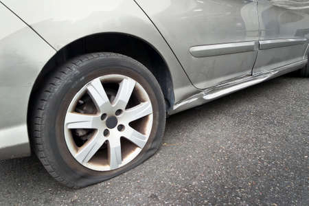 Flat rear tire on a car