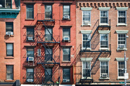 Foto de New York brick buildings with outside fire escape stairs, USA - Imagen libre de derechos