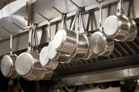 Photo for Many pans hanging in a restaurant kitchen - Royalty Free Image