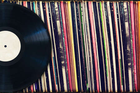 Photo pour Vinyl record with copy space in front of a collection of albums (dummy titles), vintage process - image libre de droit
