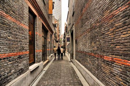 Narrow alley with brick walls, Xintiandi, Shanghai, China