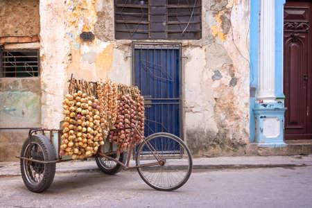 Onions seller in a street of Old Havana, Cuba