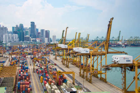 Photo pour Aerial view of the port of Singapore, the busiest asian commercial port with cargo ships and containers - image libre de droit