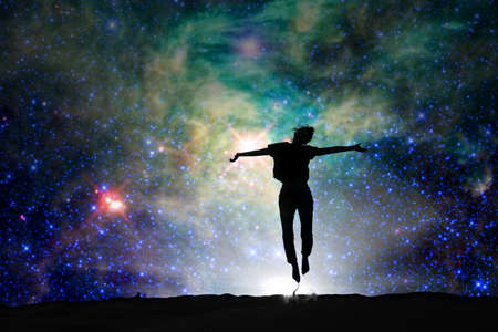 Photo pour Silhouette of a woman jumping, starry night background - image libre de droit