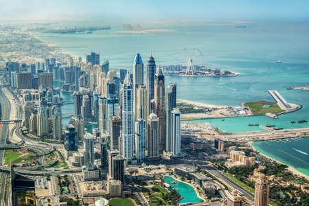 Photo for Aerial view of Dubai Marina skyline with Dubai Eye ferris wheel, United Arab Emirates - Royalty Free Image