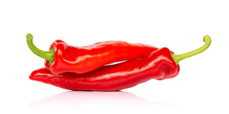 Foto de Two red hot chili pepper isolated on white background, looking like people having sex in 69 posture - Imagen libre de derechos
