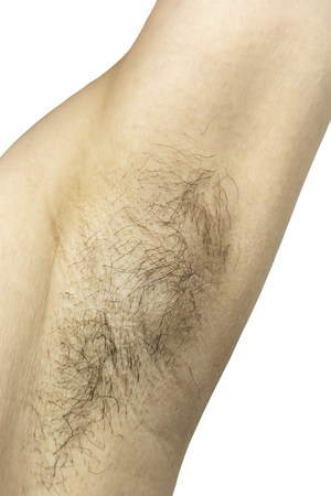 Foto de Female unshaved armpit. Isolated on white background. - Imagen libre de derechos