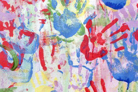 Foto de Color background of children's handprints. Multi colored hand prints. - Imagen libre de derechos