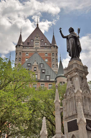 Québec, CANADA - July 18, 2013: Statue honoring the Recollets in front of the Fairmont Le Chateau Frontenac Hotel in Quebec.