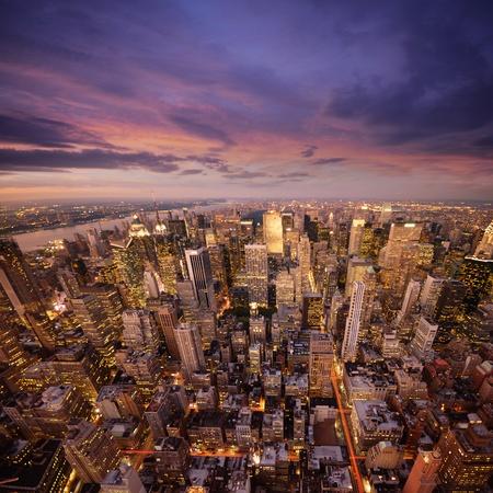 Foto de Big Apple after sunset - new york manhattan at night  - Imagen libre de derechos