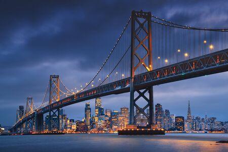 Foto de San Francisco downtown with Oakland Bridge in foreground. California famous city SF. Travel destination USA - Imagen libre de derechos