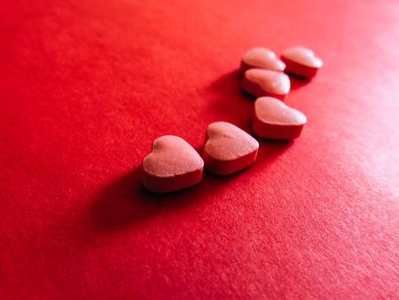 Love Heart medicine on red background. Valentines day.