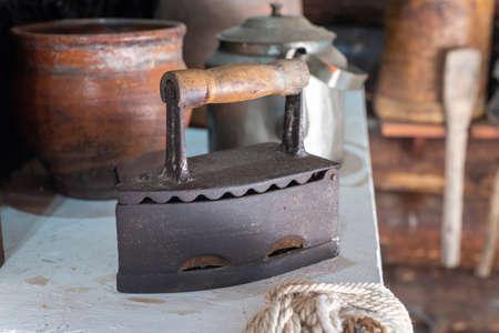 Photo pour Antique iron in a country house. - image libre de droit