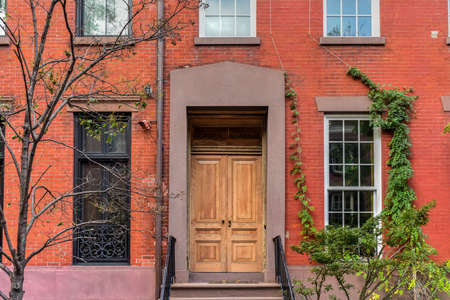 Classic Greek Revival Townhouse architecture in Greenwich Village in New York City.