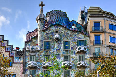 Barcelona, Spain - November 28, 2016: The facade of the house Casa Battlo (also called the house of bones) designed by Antoni Gaudi with his famous expressionistic style in Barcelona, Spain.