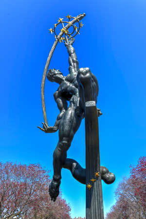 New York - Apr 21, 2018: Rocket Thrower massive bronze sculpture designed by Donald De Lue for the New York World's Fair of 1964-65 and currently in Flushing Meadows Corona Park, Queens, New York.
