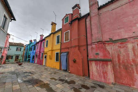 Colorful houses and canals of the island of Burano in Venice, Italy.