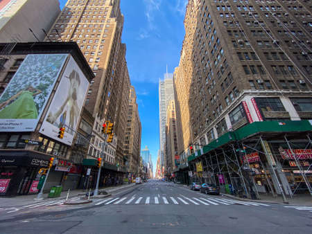 Photo for New York City - Apr 7, 2020: Empty streets of Midtown Manhattan during the Coronavirus epidemic in New York City. - Royalty Free Image