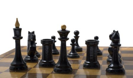 Black chess pieces on a chess board