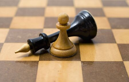 Queen chess pieces and a pawn on a white background