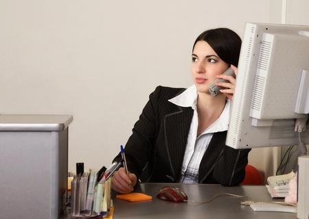 Photo pour Portrait of the pretty secretary in a office - image libre de droit