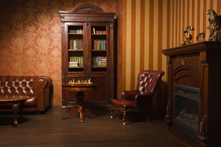 Photo pour Classical library room with leather armchair, wooden table and bookcase - image libre de droit