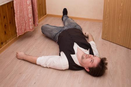 Dead man lays on a floor