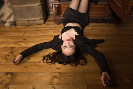 Photo for Crime scene. Dead business woman dressed black suit in the closet - Royalty Free Image
