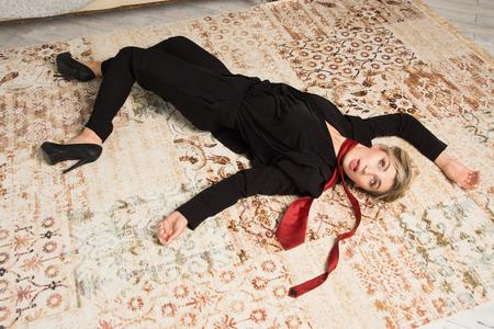 Foto de Crime scene with strangled  business woman (imitation) - Imagen libre de derechos