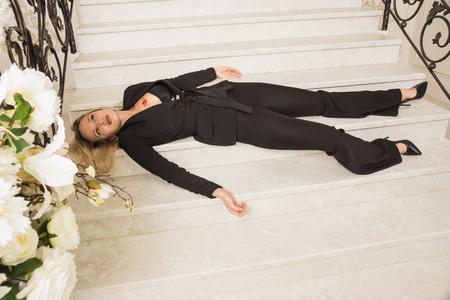 Foto de Crime scene. Business woman shot to death on the luxury stairs - Imagen libre de derechos