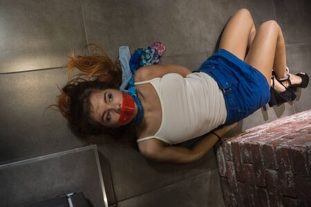 Photo for Crime scene simulation: dead girl in the handcuffs lying on the floor - Royalty Free Image