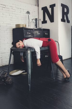 Photo for Crime scene with strangled pretty business woman in office - Royalty Free Image