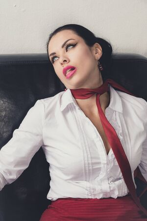 Foto de Crime scene (imitation). Strangled business woman lying on the couch - Imagen libre de derechos