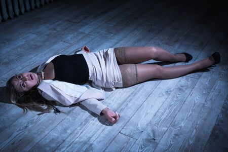 Photo for Crime scene with strangled pretty business woman lying on the floor - Royalty Free Image