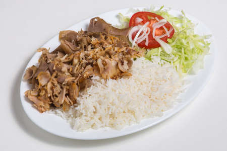 Photo for Plate with Kebab and Rice isolated on white - Royalty Free Image