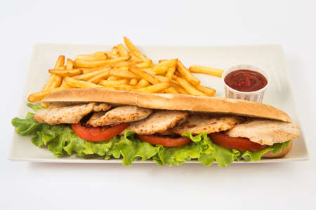 Foto de Sandwich with chicken, cheese and golden fries potatoes - Imagen libre de derechos
