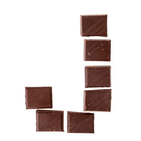 Foto de J- Isolate chocolate letter, alphabet on white background - Imagen libre de derechos