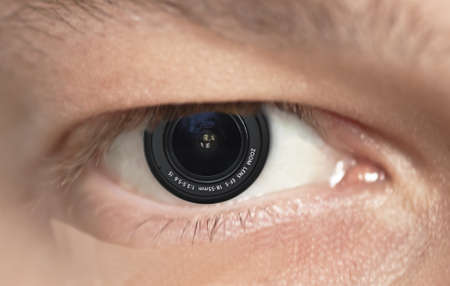 Photo of an eye of the man with a lens a pupil place