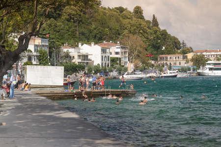 Istanbul, Turkey - August 19, 2016 : Turkish children are swim to cool off the coast of Sariyer.
