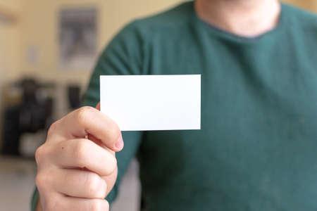 Photo pour Business Card Mock-Up - Man Holding a Blank Card for Clients. Business Card Template. - image libre de droit